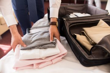 businessman packing bags for travel 9ZG6BUL