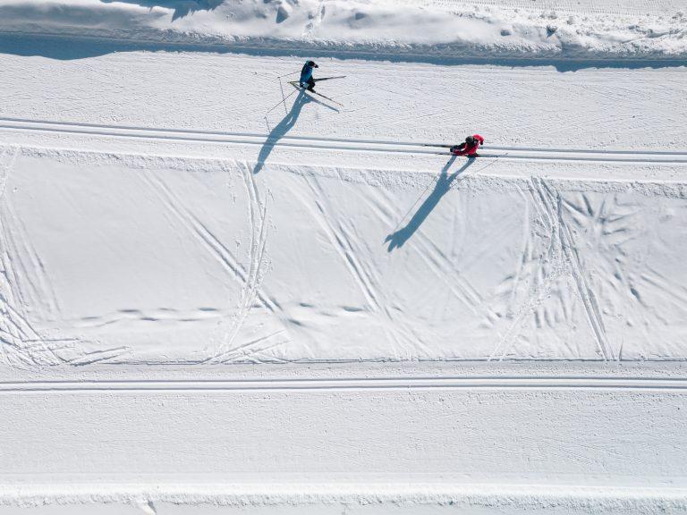 aerial view of ski tracks in snow men skiing in fi FP7H9CE