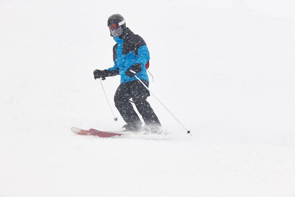 skiing under the snow winter sport ski slope horiz AKW2YUG