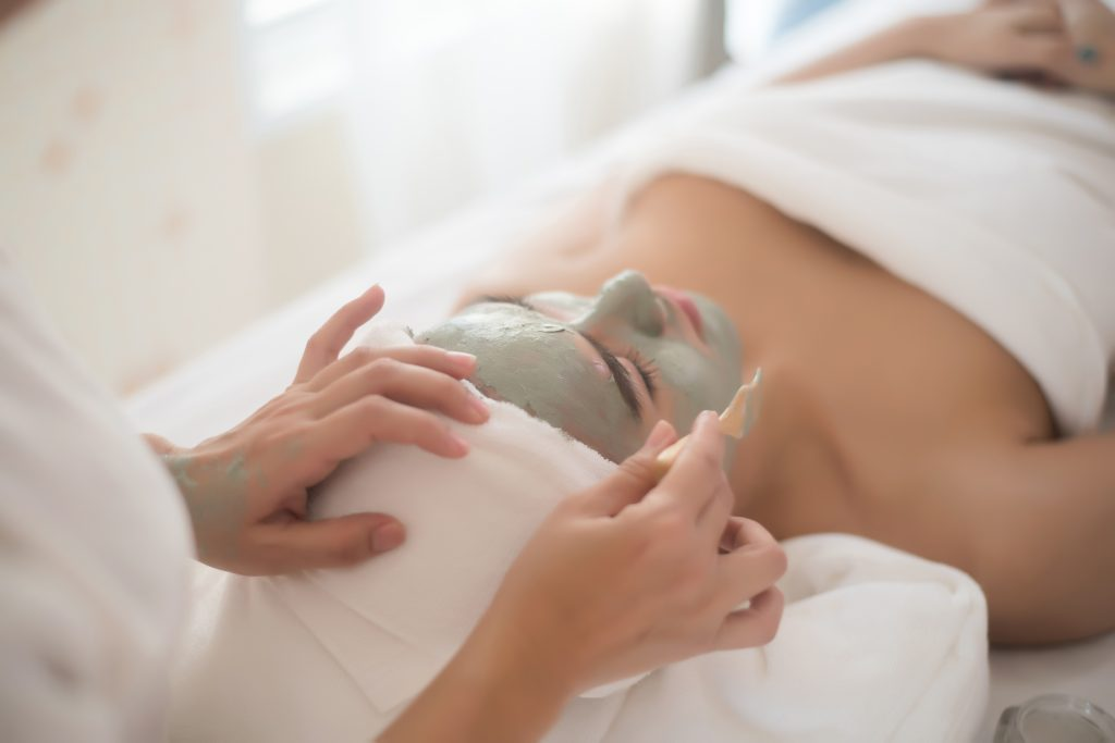 beautiful woman lying on spa mask face with treatm VZHW4UR
