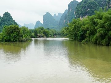 landscape shot of beautiful natural riverway with karst mountains in one of chinas most popular t20 P13djQ
