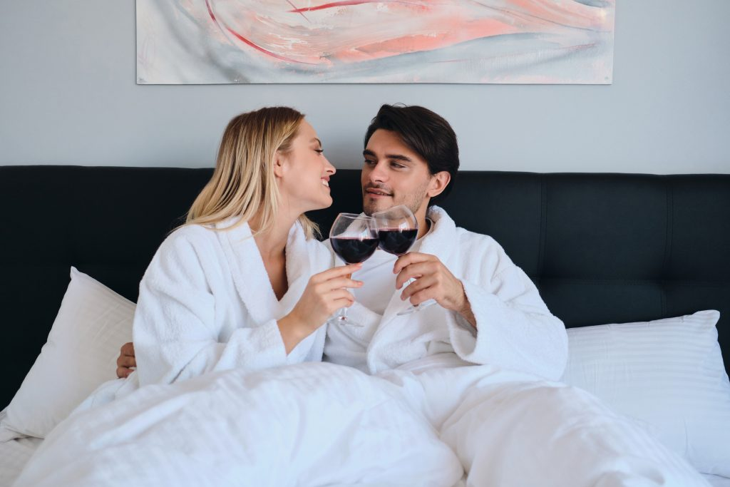 young beautiful couple lying in bed in modern cozy MVD462Y